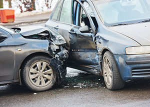 One Dead, Two Injured in Two-Vehicle Car Crash